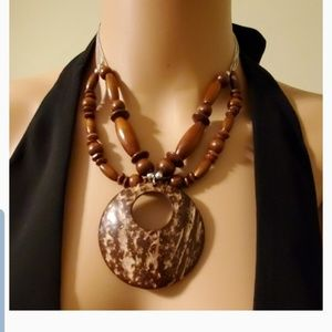 Boho coconut shell necklace with beaded earrings.